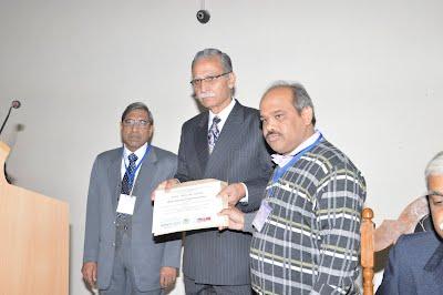 First Prize winner (Prof Ekram Khan receiving on behalf Mohammad Farhan khan)